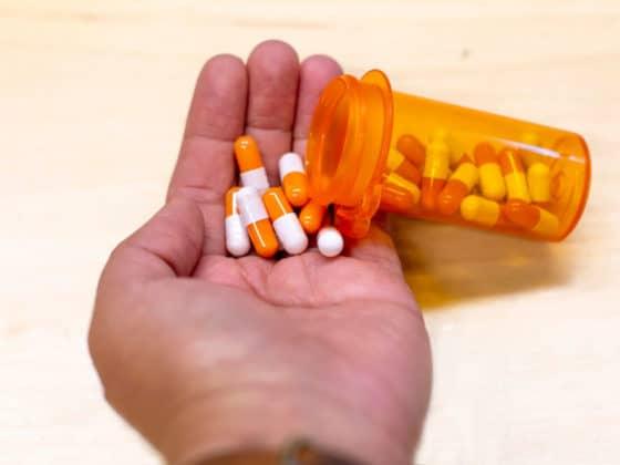 Healthcare medication orange bottle with pill drugs