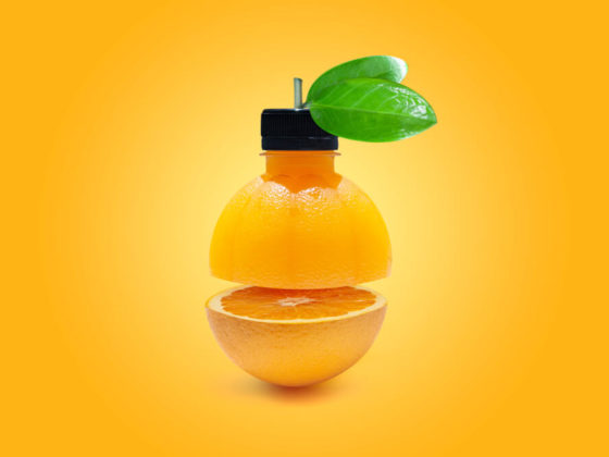 Fresh orange isolated on orange background.Juicy and sweet and renowned for its concentration of vitamin C