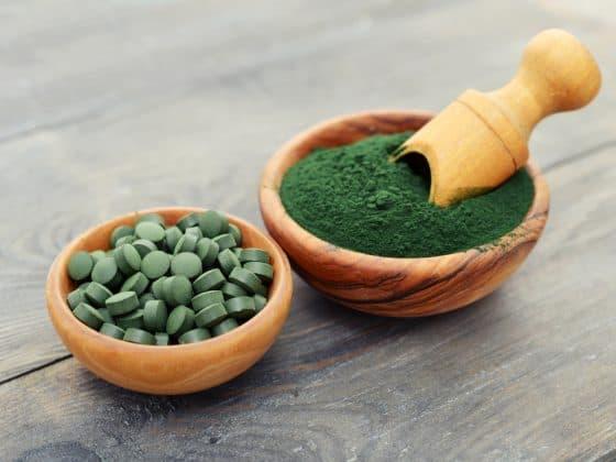 Green tablets and green powder of chlorella.