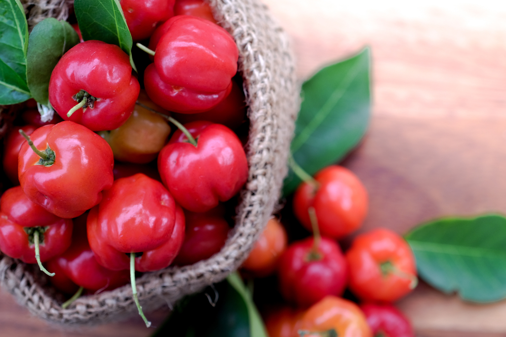 A bag of red acerola cherries.